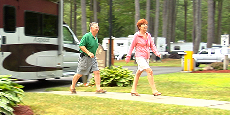 Couple outside their RV at Ledgeview Campgrounds in Lake George NY